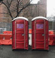 Red porta potties for events in Manhattan, NY