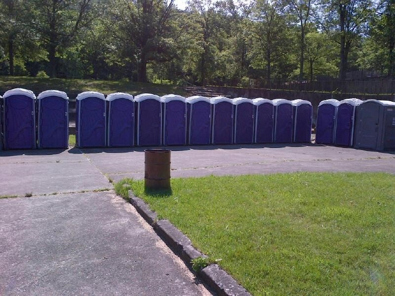 row of porta potties at park in New York