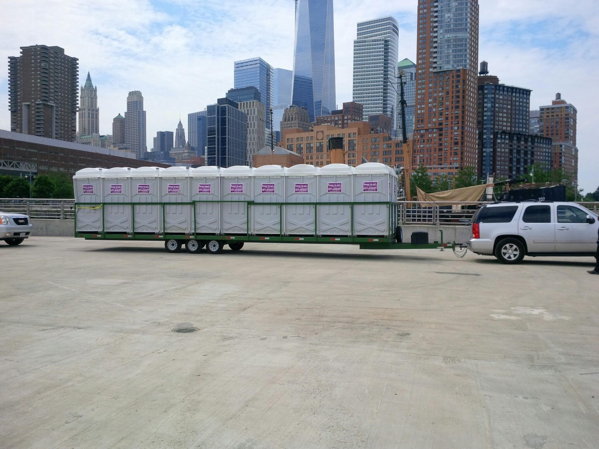 porta potty units being delivered