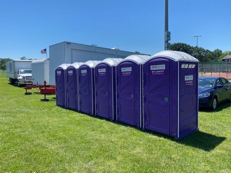 row of john to go porta potty units